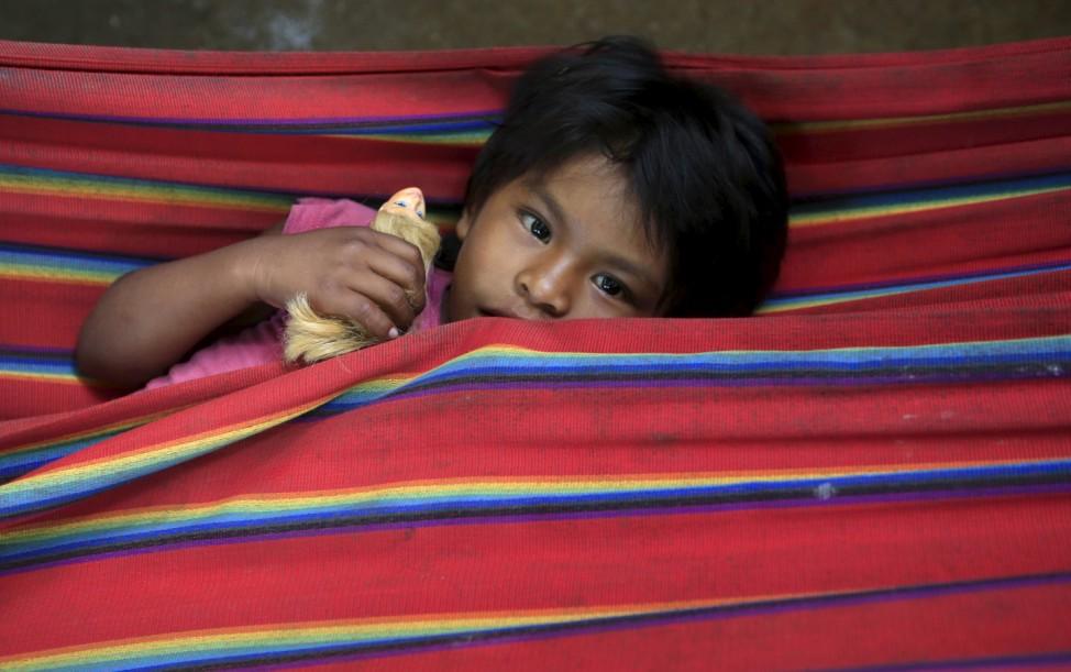 Colombian Nukak Maku Indian child rests in a refugee camp at Agua Bonita near San Jose del Guaviare