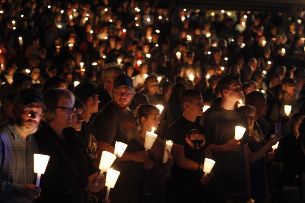 People take part in candle light vigil following a mass shooting at Umpqua Community College in Roseburg Oregon