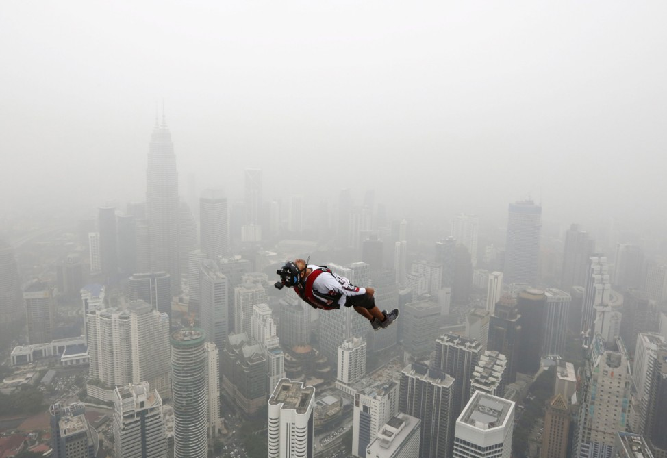 BASE jumper leaps from the 300-metre high Kuala Lumpur Tower during the International Tower Jump on a hazy day in Kuala Lumpur