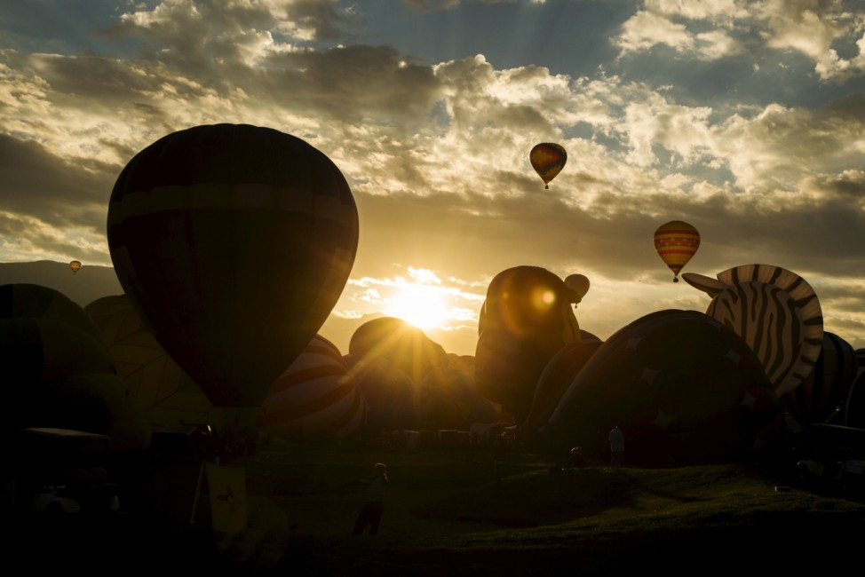 Hot air balloons lift off as the sun rises over the first day of the 2015 Albuquerque International Balloon Fiesta in Albuquerque, New Mexico