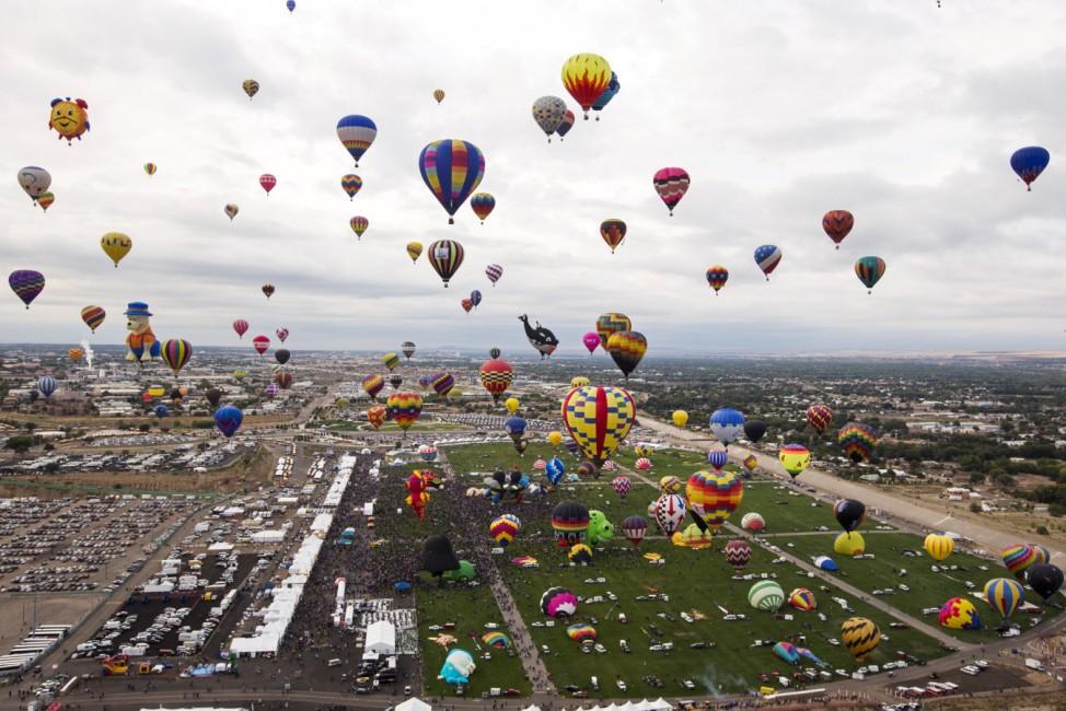 Hundreds of hot air balloons take off during the 2015 Albuquerque International Balloon Fiesta in Albuquerque