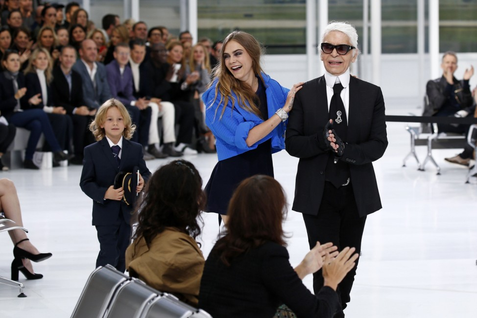 German designer Karl Lagerfeld and model Cara Delevingne appear at the end of his Spring/Summer 2016 women's ready-to-wear show for fashion house Chanel in Paris
