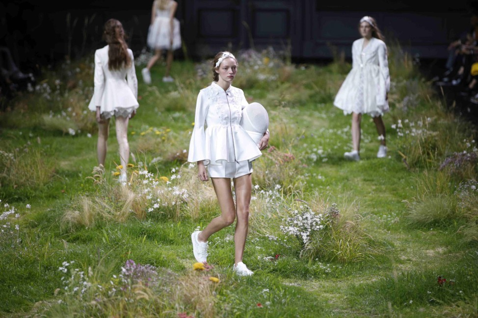 Models present creations by Italian designer Giambattista Valli as part of his Spring/Summer 2016 women's ready-to-wear collection for Moncler Gamme Rouge in Paris