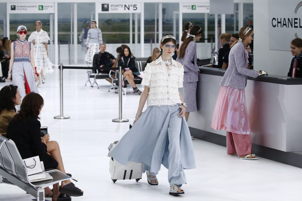 A model presents a creation by German designer Karl Lagerfeld as part of his Spring/Summer 2016 women's ready-to-wear show for fashion house Chanel in Paris