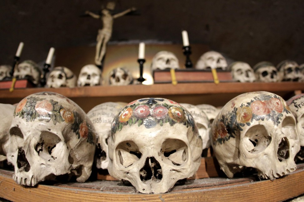 Human skulls and bones are displayed at the Bone House in Hallstatt