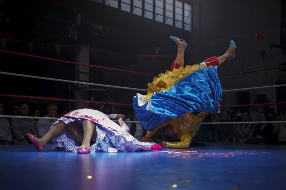 Bolivian wrestlers Mamani, nicknamed Martha 'La Altenaâĝ and Cordova, nicknamed Angela 'La Simpatica', battle during a wrestling bout in Madrid
