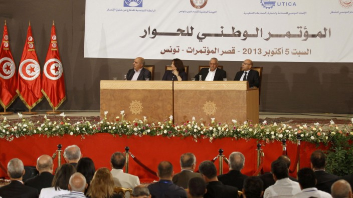 File photo of members of Tunisia's National Dialogue Quartet looking on during a National Conference for Dialogue in Tunis