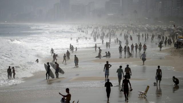 People gather in Ipanema beach in Rio De Janeiro