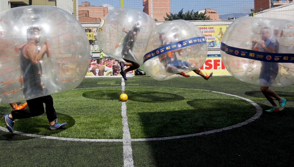 People take part in a game of 'bubble bump soccer' during an exhibition tournament in Medellin, Colombia