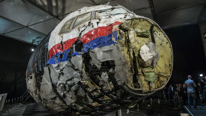 Reconstructed wreckage of the MH17 airplane is seen after the presentation of the final report into the crash of July 2014 of Malaysia Airlines flight MH17 over Ukraine, in Gilze Rijen, the Netherlands