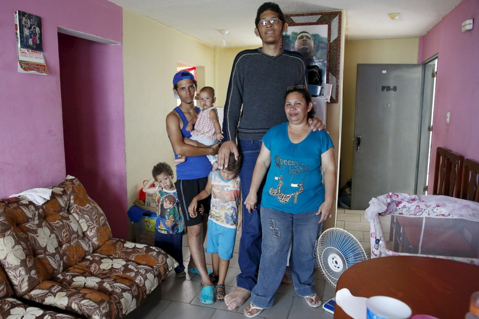 Jeison Rodriguez, the living person with the largest feet, poses for a picture with his mother Amalia, his brother Erick, and his nephews at their house in Maracay, Venezuela