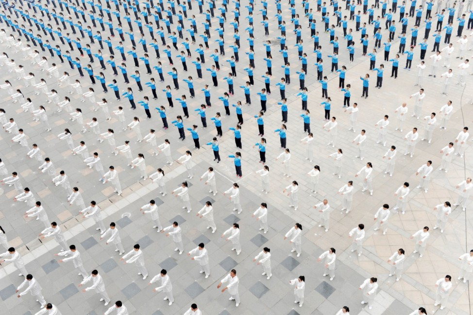 People practice Taichi at a square in Qinyang, Henan province