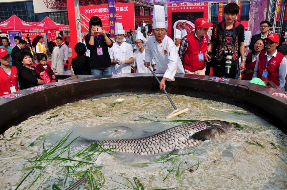 Fish weighing over 80 kilogram is cooked in a hotpot during a food festival in Zhengzhou