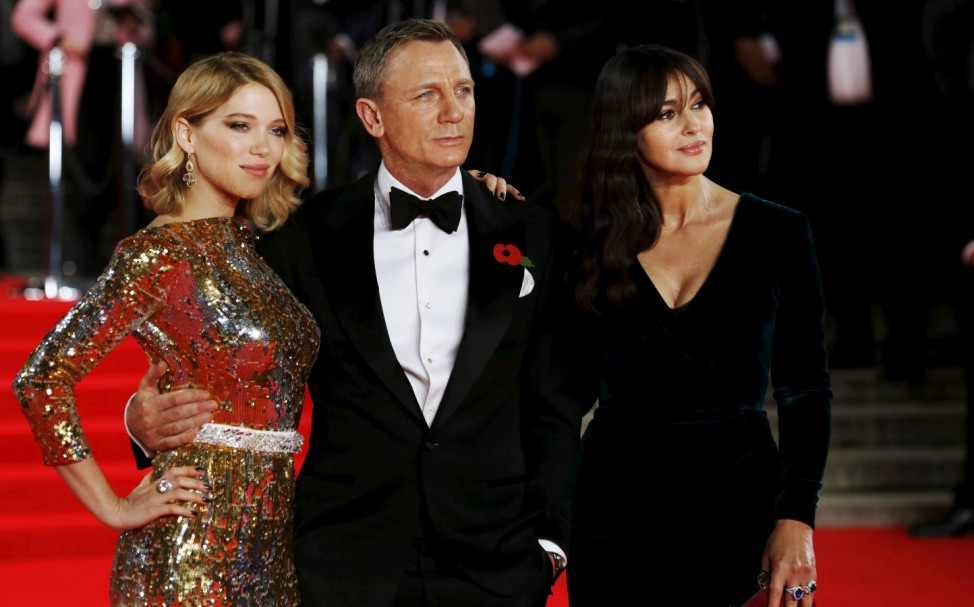 Lea Seydoux, Daniel Craig and Monica Bellucci pose for photographers as they attend the world premiere of the new James Bond  007 film 'Spectre' at the Royal Albert Hall in London, Britain