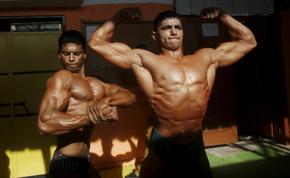 Palestinian contestants pose before a local bodybuilding championship in Gaza City