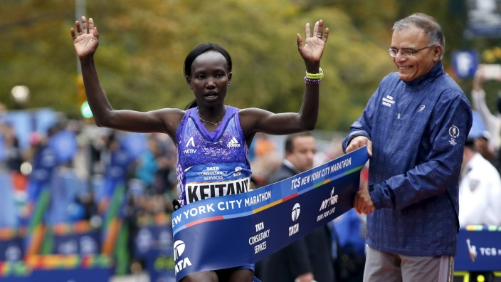 Mary Keitany of Kenya crosses the finish line to win the women's division of the 2015 New York City Marathon in New York's Central Park
