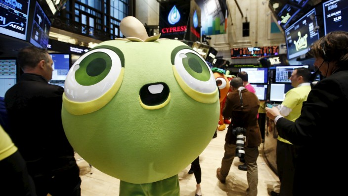 File photo of a mascot dressed as a character from the mobile game 'Candy Crush Saga' walking the floor of the New York Stock Exchange during the IPO of Mobile game maker King Digital Entertainment Plc