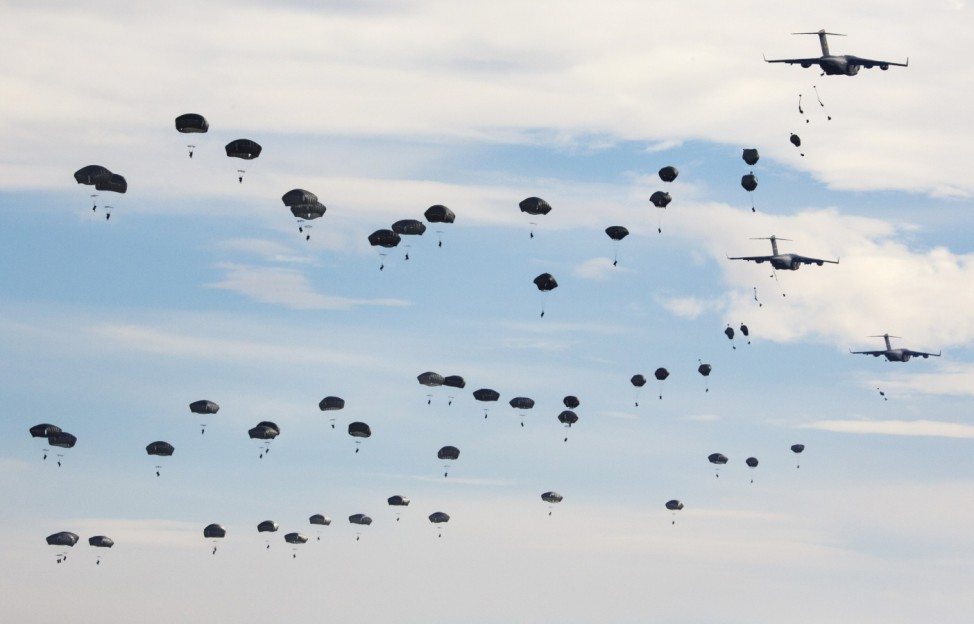 U.S. Paratroopers from the 82nd Airborne Division participate in a massive airdrop from C-17 Globemaster aircraft as part of the NATO Exercise Trident Juncture 2015 military exercise, at the San Gregorio training grounds outside Zaragoza