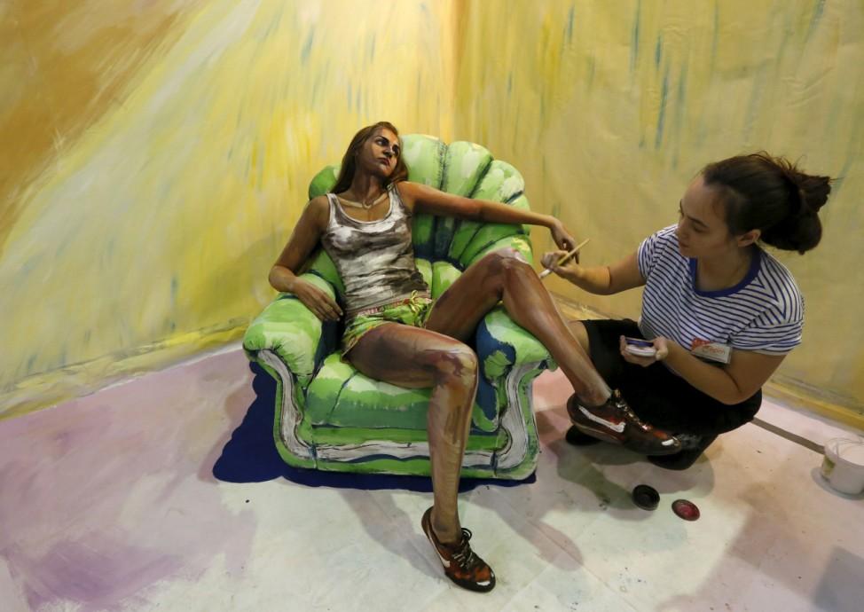 Russian artist Maria Gasanova works on her 'The Alive Painting' body art project during the Art Krasnoyarsk annual festival in Krasnoyarsk