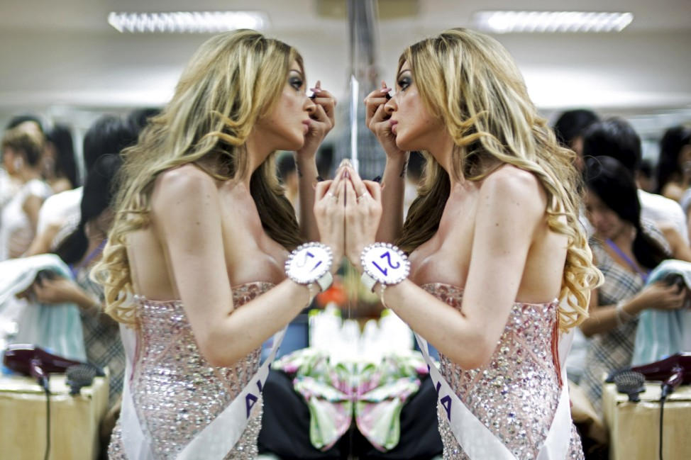 Contestant Taliah of Australia prepares backstage before the final show of the Miss International Queen 2015 transgender/transsexual beauty pageant in Pattaya