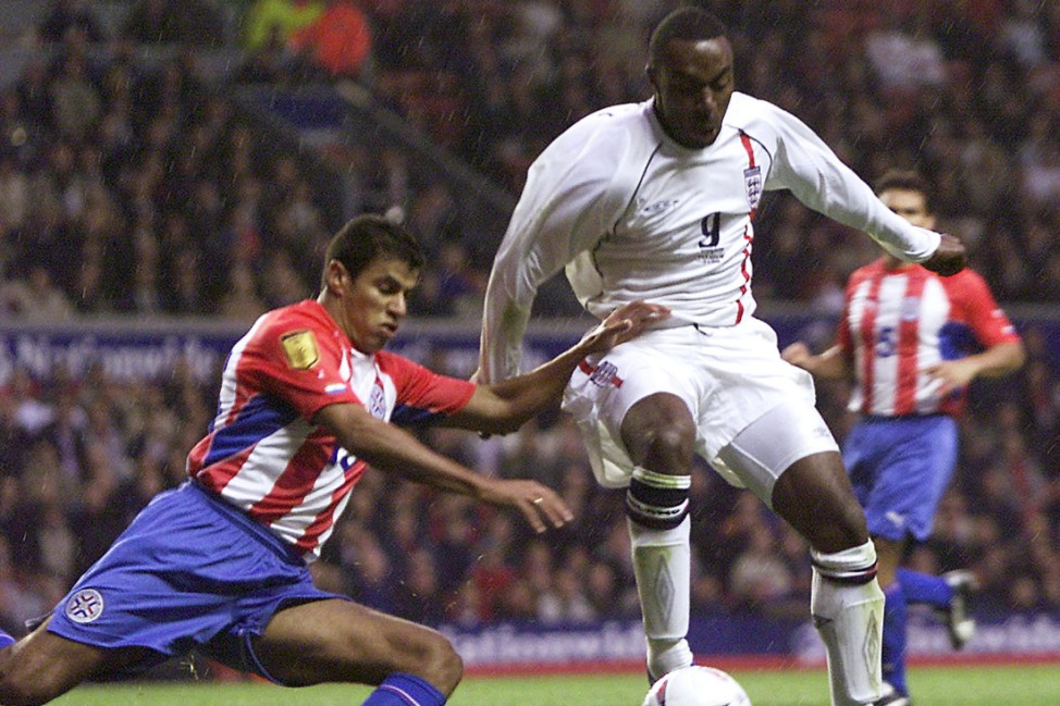 ENGLAND'S VASSELL IS TACKLED BY PARAGUAY'S BONET AT ANFIELD