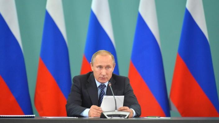 Vladimir Putin visits a sport center in Sochi