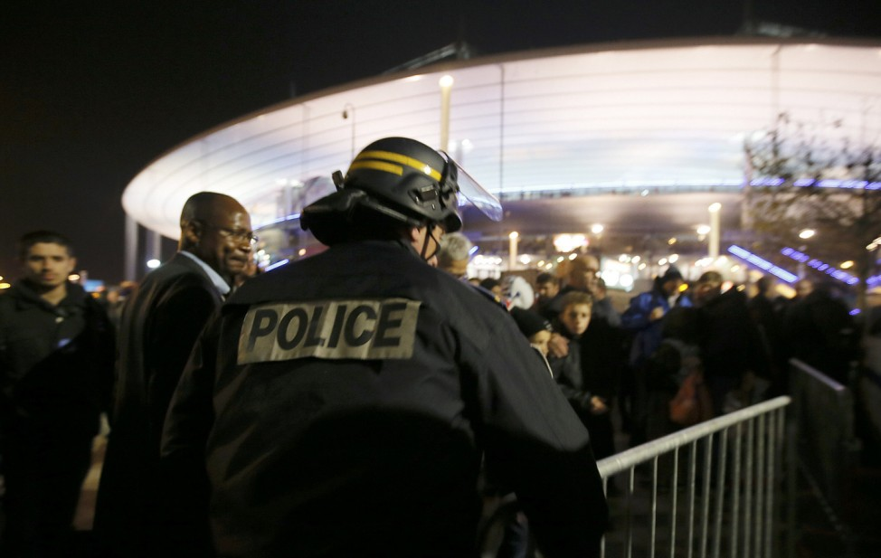 Police control crowds leaving the Stade de France soccer stadium where explosions were reported during the France vs German friendly match