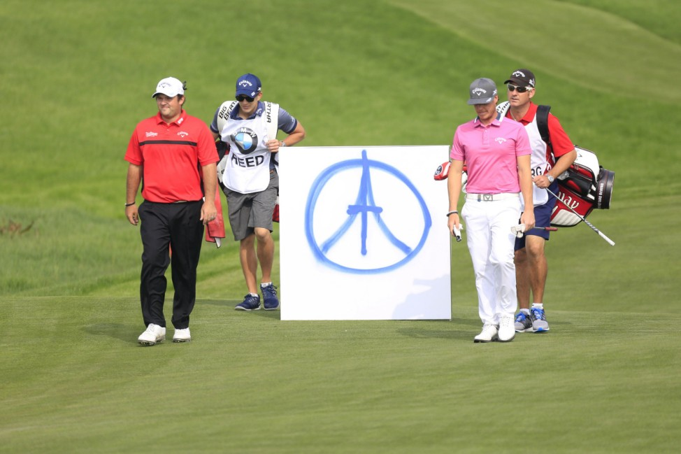 Patrick Reed of the U.S. and Kristoffer Broberg of Sweden stand next to a peace symbol  during the BMW Masters 2015 golf tournament at Lake Malaren Golf Club in Shanghai