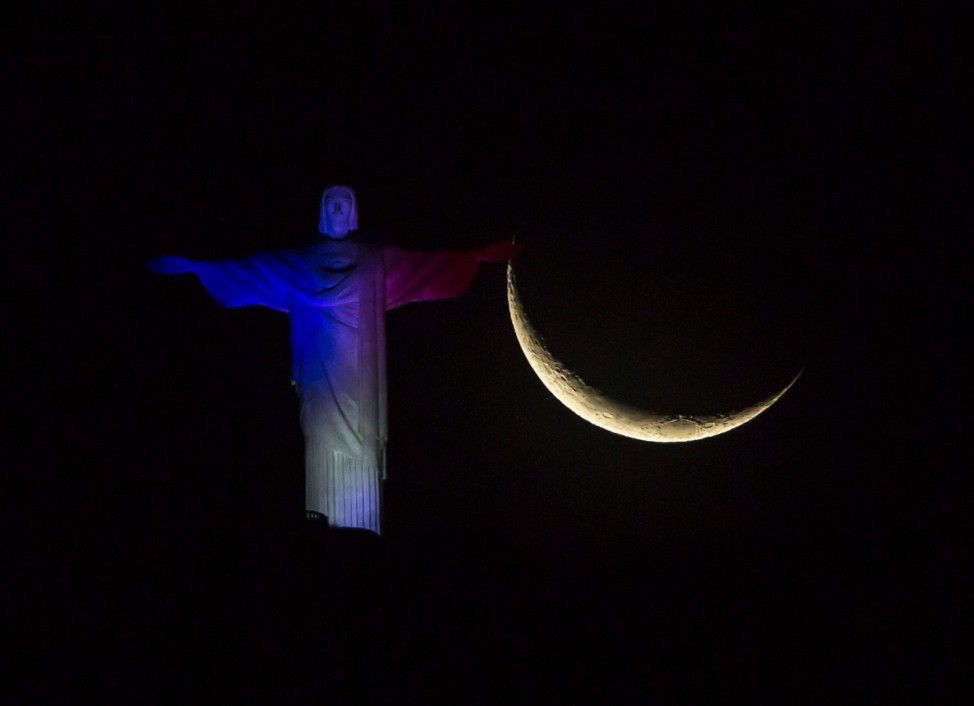 Cristo Redentor is illuminated with colors of the France flag