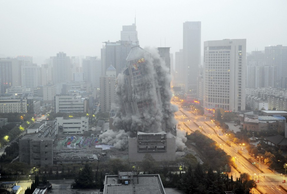 A building crumbles during a controlled demolition to make way for a new commercial centre in Xi'an