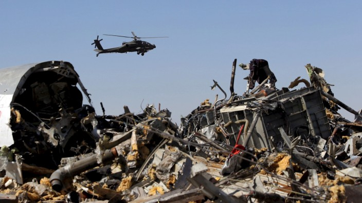 File photo shows an Egyptian military helicopter flying over debris from a Russian airliner which crashed at the Hassana area in Arish city