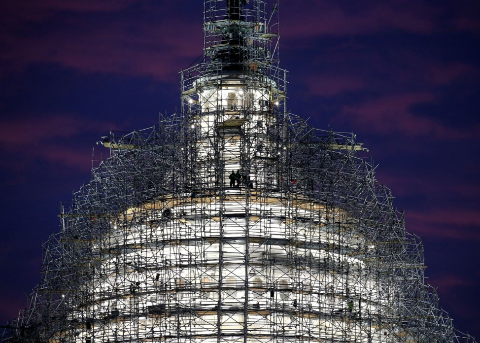 Workers StandOn Scaffolding That Surrounds The Dome Of The US Capitol