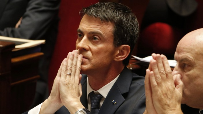 French Prime Minister Manuel Valls attends a debate to extend a state of emergency, at the National Assembly in Paris