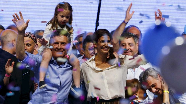 Macri, presidential candidate of the Cambiemos coalition, with his daughter Antonia on his shoulders, and his wife Awada wave to supporters after the presidential election in Buenos Aires, Argentina