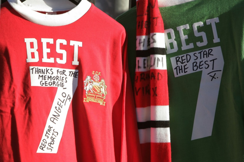 Soccer shirts with Best's name and number hang on the railings outside Old Trafford Manchester England