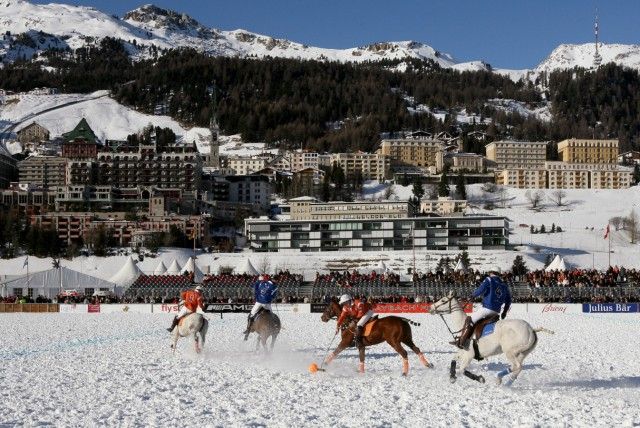 File photo of members of Team Juius Baer and Team Maybach playing during their polo match at the Cartier World Cup On Snow tournament in St. Moritz