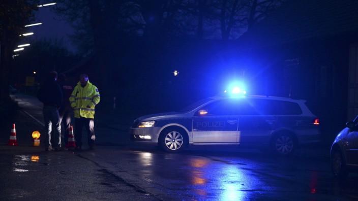 Police block road during international manhunt operation in North Rhine-Westphalia