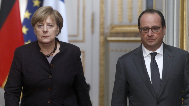 French President Francois Hollande Receives  German Federal Chancellor Angela Merkel At Elysee Palace