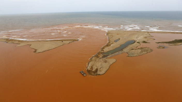 An aerial view of the mouth of Rio Doce, which was flooded with mud after a dam owned by Vale SA and BHP Billiton Ltd burst, at an area where the river joins the sea on the coast of Espirito Santo in Regencia Village