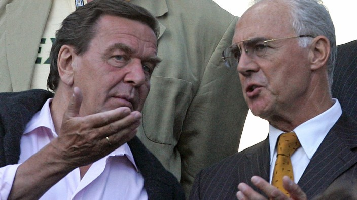 Germany's Chancellor Schroeder and Beckenbauer wait for a Confederations Cup match in Hanover