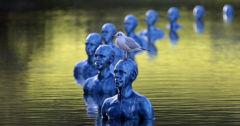 A seagull stands on the art-work 'Where the Tides ebb and flow' by Argentinian artist Pedro Marzorati installed in a pond at the Montsouris park ahead of the COP21 World Climate Summit in Paris