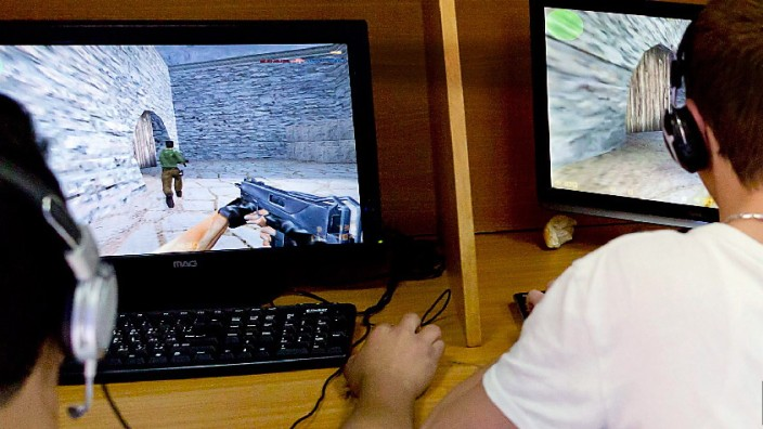 Palestinian youth play PC games at internet cafe in Jerusalem