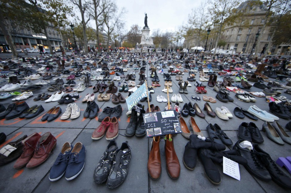 Pairs of shoes are symbolically placed on the Place de la Republique, after the cancellation of a planned climate march following shootings in the French capital, ahead of the World Climate Change Conference 2015 (COP21)