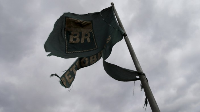 A flag of Brazil's state-run Petrobras oil company is pictured at a gas station in Mariana