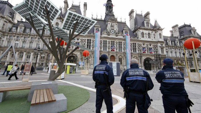 Paris city hall security employees patrol at the exhibition 'Paris de L'Avenir', a showcase for tangible climate solutions in the context of the COP21 World Climate Summit, in front of Paris city hall