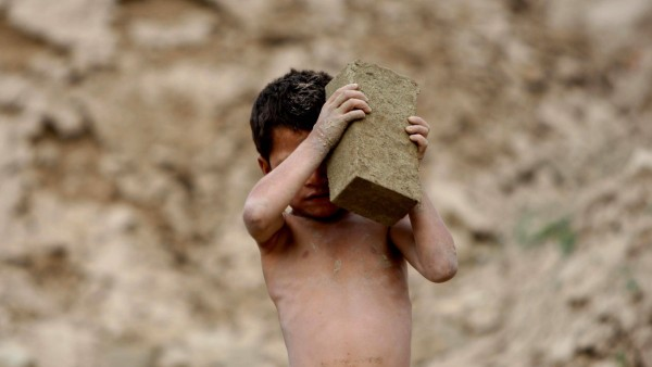 150803 KABUL Aug 3 2015 An Afghan child works at a brick factory on the outskirts of Kabu
