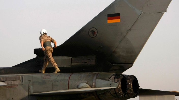 File photo of a German soldier walking on a Tornado fighter jet before a reconnaissance flight from the German camp in Mazar-e-Sharif