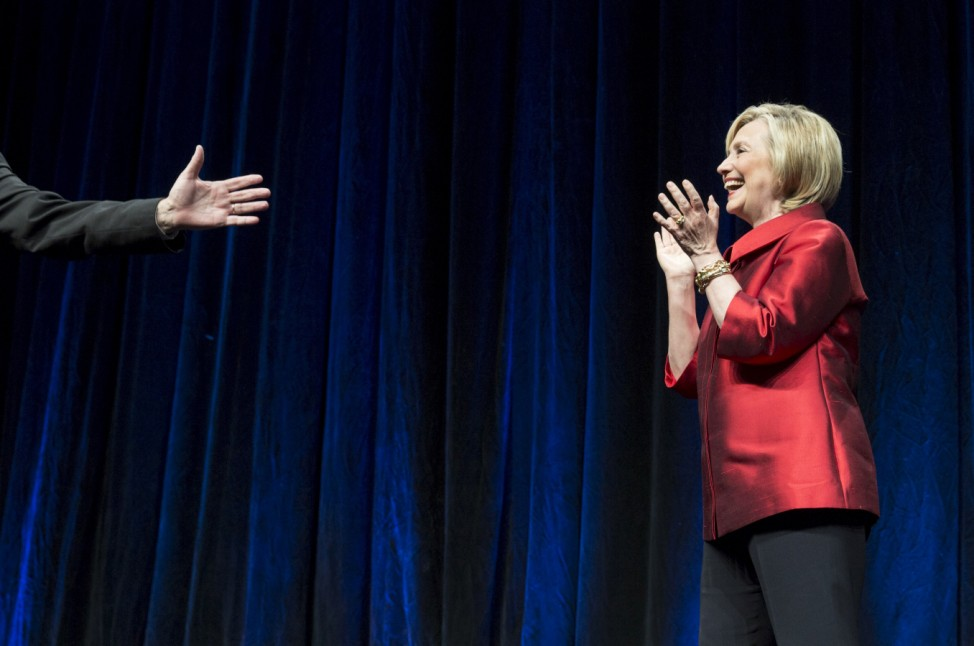 U.S. Democratic presidential candidate Hillary Clinton is introduced by Virginia Governor Terry McAuliffe before speaking at the Virginia Democratic Party's annual Jefferson-Jackson party fundraising dinner