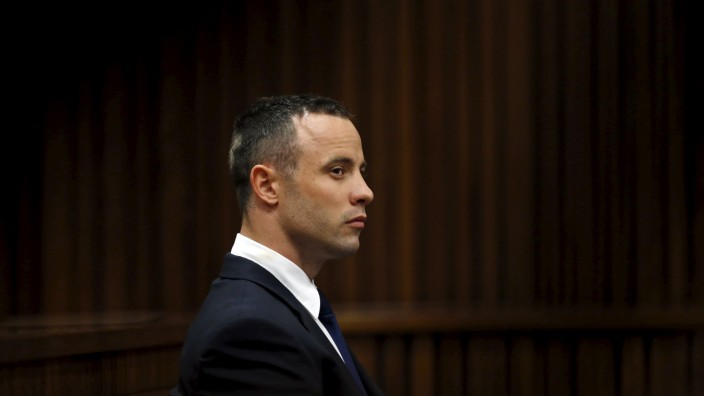 File photo of Olympic and Paralympic track star Pistorius sitting in the dock in the North Gauteng High Court in Pretoria