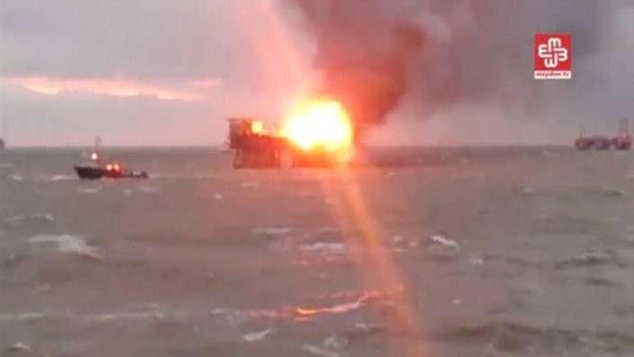 A still image from a video footage shows an oil platform on fire in the Caspian Sea